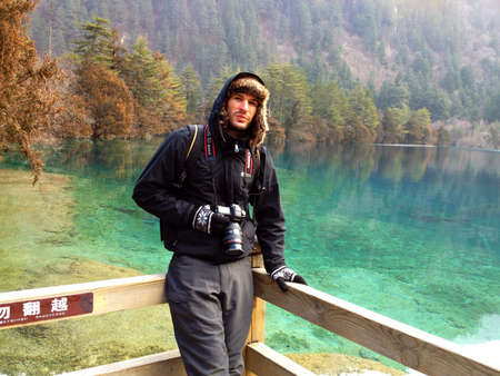 Man with camera in jiuzhaigou China