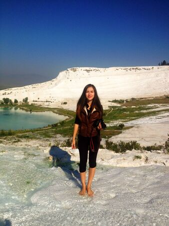 Woman with camera in Pamukkale Turkey  Stock Photo