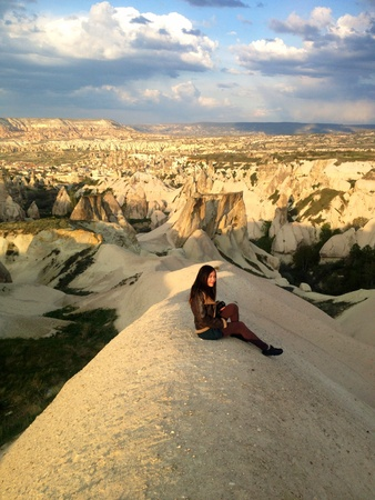 Woman with camera sitting in Cappadocia  Stock Photo