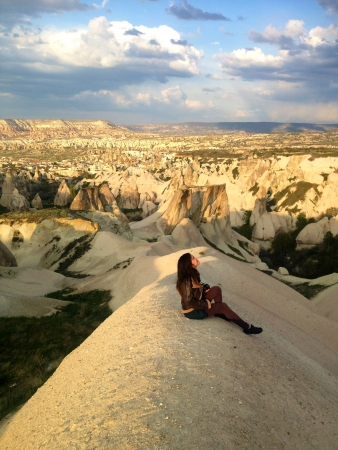 Woman sitting and looking at the sky in Cappadocia  Stock Photo