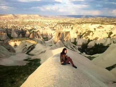 Woman sitting in Cappadocia landscape