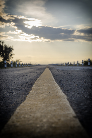 leading light: Straight way on the road leading into the light Stock Photo