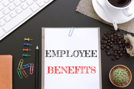 Text Employee benefits on white paper background  business concept
