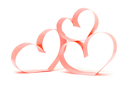 Valentines day card - heart made of ribbon on white background. Stock Photo