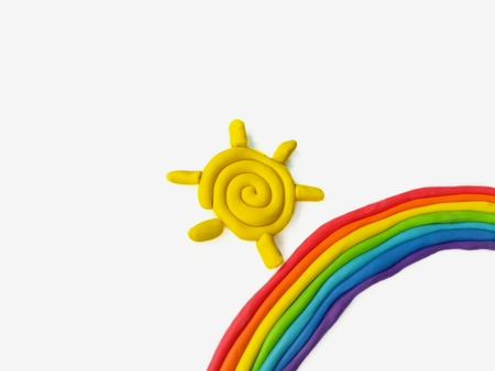 Colorful plasticine clay made are beautiful rainbow and yellow sun on white background,cute nature dough