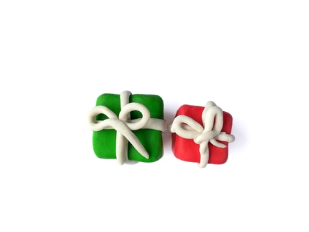 Colorful clay plasticine made are Green and red gift boxes with white ribbon,Regardless of whether the gift is small or large, it can also make the recipient happy.