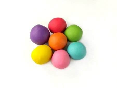 Colorful clay plasticine made are cute balls placed on white background,beautiful flower shape dough Stock Photo
