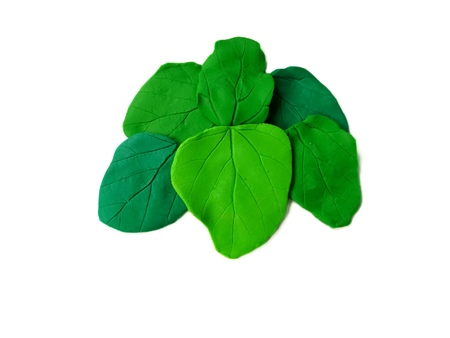 Beautiful green leaves made from plasticine clay on white background,natural dough Stock Photo