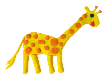 Cute yellow giraffe made from plasticine clay on white background,lovely long neck animal dough