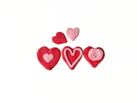 Pink and red plasticine clay dough made are beautiful variety hearts on white background Stock Photo