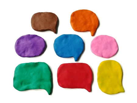 Colorful abstract shape made from plasticine clay on white background, Speech bubble dough Stock Photo