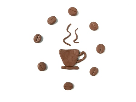 Delicious hot coffee made from plasticine clay and coffee beans arrange circle around it on white background, brown color dough