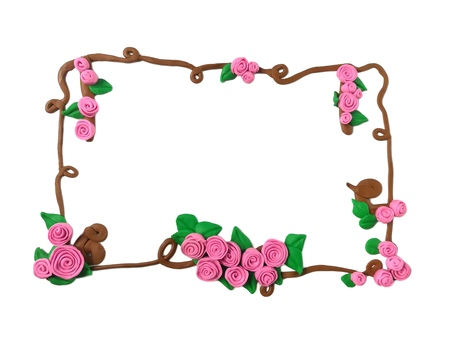 Sweet pink tone rose flower with branch handmade from plasticine clay arrange as a frame are beautiful on white background, cute floral dough