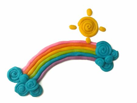 Colorful plasticine clay handmade are beautiful rainbow clouds and sun on white background,  cute natural dough Reklamní fotografie