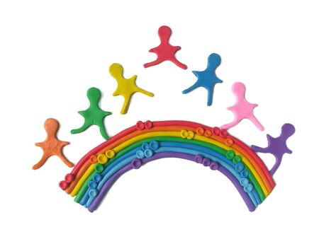 The beautiful rainbow has children running play on top made from colorful plasticine clay are placed on white background, cute shaped are dough