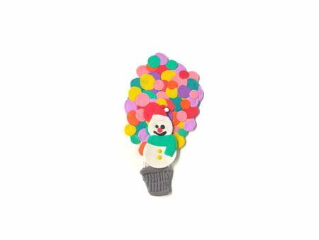 Cute smiley snowman and balloon baskets decorated with colorful balloon made from plasticine clay floating up into the sky are beautiful placed on white background, cute shaped are dough