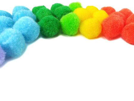 Beautiful pom pom decorate are rainbow shape made from colorful fiber yarn placed on white background,  creative small circle are cute curve on top frame Reklamní fotografie