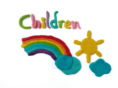 Children text decorated on a beautiful rainbow, with sun and cloud made from colorful plasticine clay on white background, cute shaped on sky are dough Reklamní fotografie