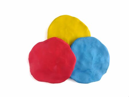 Colorful circle shape made from plasticine clay arrange overlap on white background, Red yellow and blue speech bubble dough Reklamní fotografie