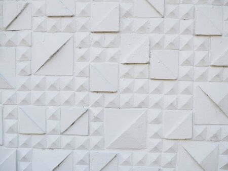 White geometric embossed stucco large and small rectangle pattern concrete tile wall, with diagonal corner details Stok Fotoğraf