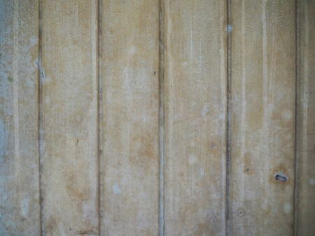 grooves: Old yellow black dirty stained pale blue peeled off painted vertical groove line stripe pattern wall background