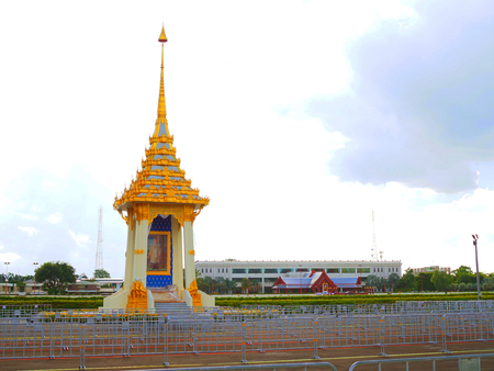 Bangkok, Thailand - October 17, 2017: Mocked up crematorium station for King Rama IX with golden painted pagoda decoration, and many stacked fences to arrange queue, opposite to Navy Meeting Hall