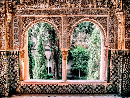 moorish: moorish window with arches looking into courtyard