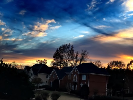 subdivision: twilight sky in a subdivision with brick houses Stock Photo