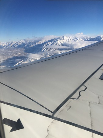 view of snowy mountains from the sky