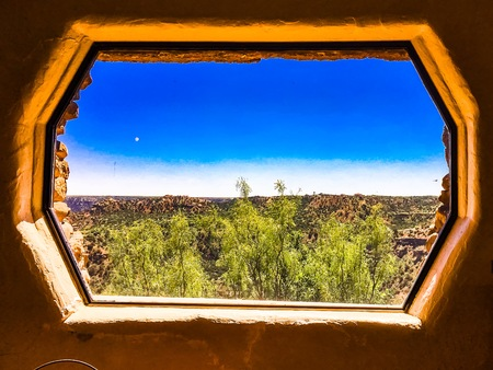 geological formation: Window looking out into canyons in desert