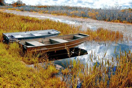 tin boats on the shore of the autumn marsh