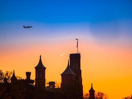plane over building silhouette Stock fotó