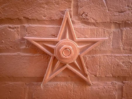 star on red brick wall