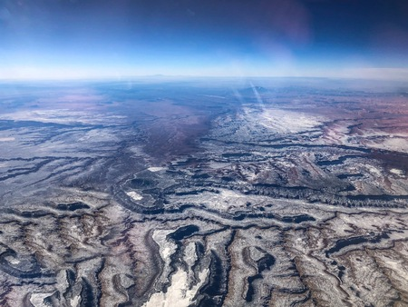 aerial view of the desert and snow-capped mountains in Colorado Stock Photo