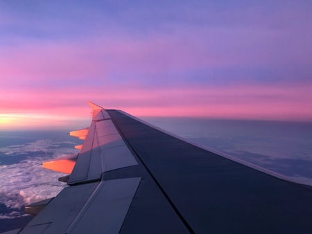 aerial sunrise over airplane wing in flight Imagens