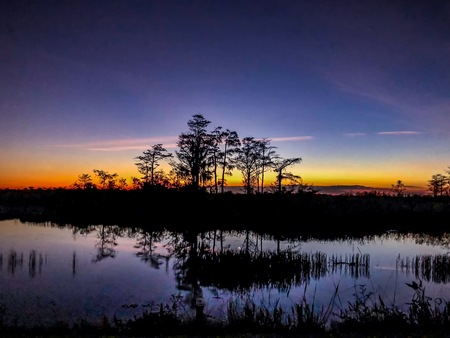 sunset over the river and bayou in the marsh