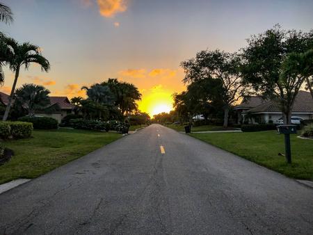 quiet street at sunset in suburban neighborhood Stock Photo