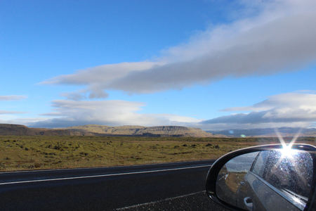 rear view mirror while driving on the Ring Road, Route 1, in Skeidararsandur at Skaftfell, Southern Region, Iceland