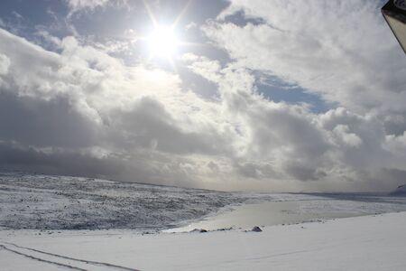 top of a white mountain on a glacier