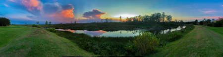 Colorful swamp sunset in Louisiana reflecting on American values. Stock Photo