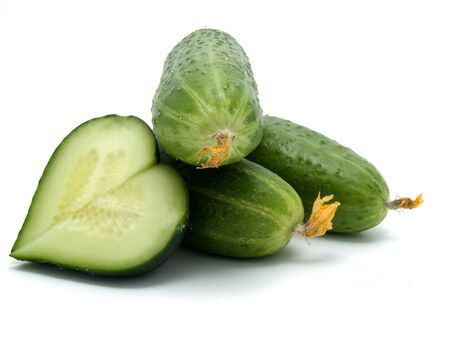 Three cucumbers and heart on a white  background