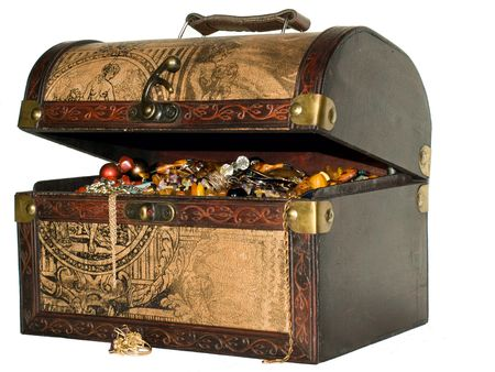 A wooden treasure chest filled with loot.  Stock Photo