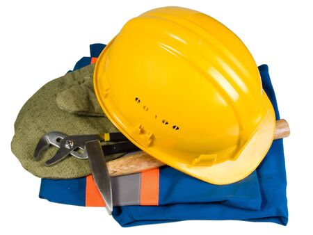 Yellow helmet, mittens, instrument and clothes for work photo