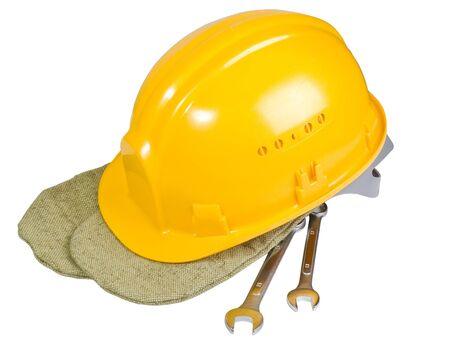 Yellow helmet, mittens, instrument for work