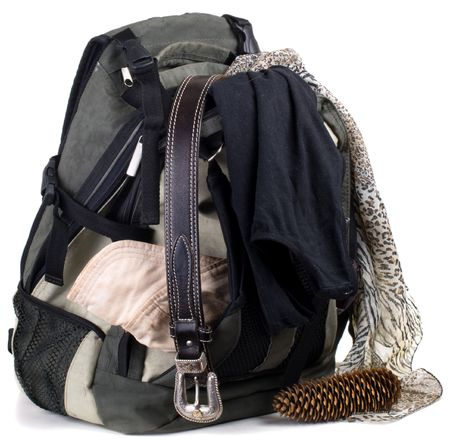 Backpack with clothes  isolated on white background Stock Photo - 5328922