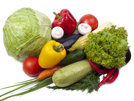 Full frame photograph of a broad variety of vegetables; colorful and plentiful photo