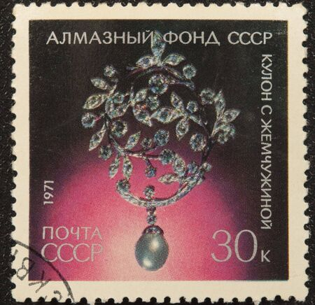 coulomb:  Postal vintage stamp depicting coulomb with pearl, exhibited in Diamond Fund.