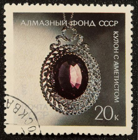 coulomb:  Postal vintage stamp depicting coulomb with Amethyst, exhibited in Diamond Fund.  Stock Photo