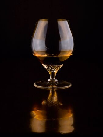 alcoholic beverage in glass on a dark background