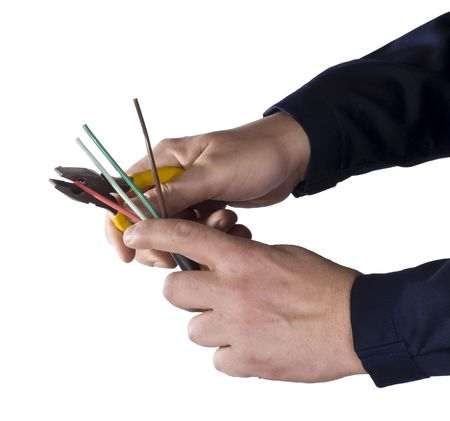 wire stripper   in the hands of worker Stock Photo